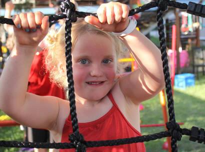 Make-A-Wish Australia wish kid Juniper climbing on her backyard ninja warrior obstacle course