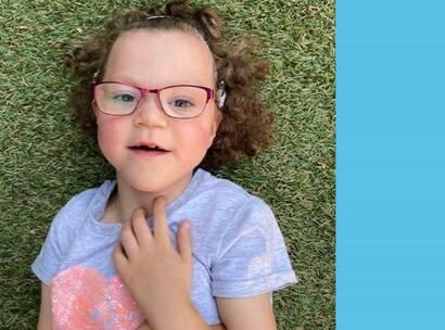 Make-A-Wish Australia wish kid Hannah lying on grass