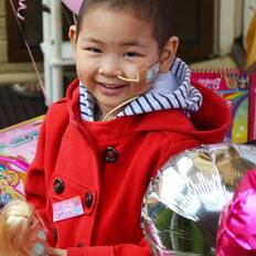 Make-A-Wish wish kid Maple with her Barbies