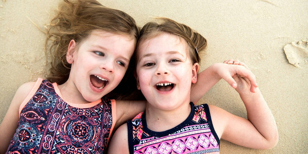 Make A Wish Australia Children's Charity - Audrey with her sister on the beach laughing