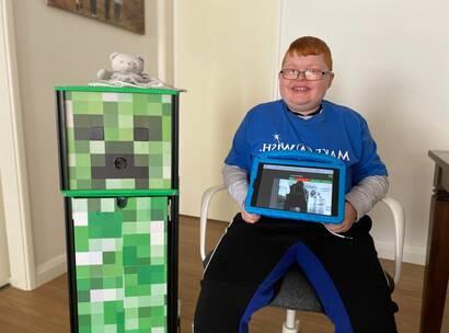 Make-A-Wish Australia wish kid Charlie sat with his robot