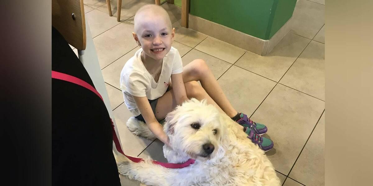 Make-A-Wish wish kid Scarlett with her dog