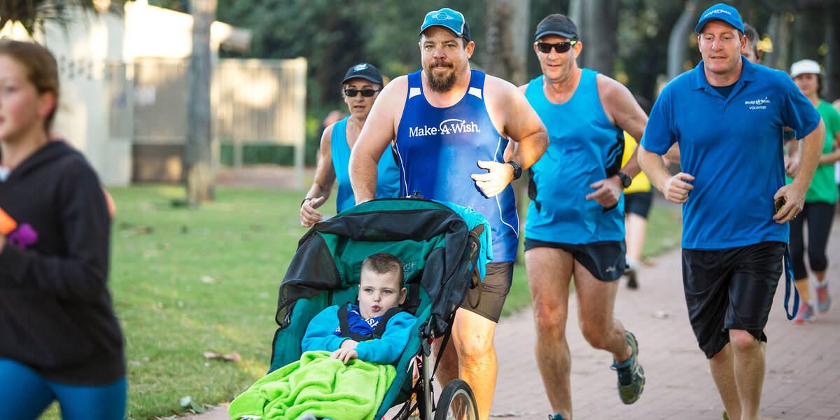 Make A Wish Australia Children's Charity - Aedan on his wish running with team wish and his dad