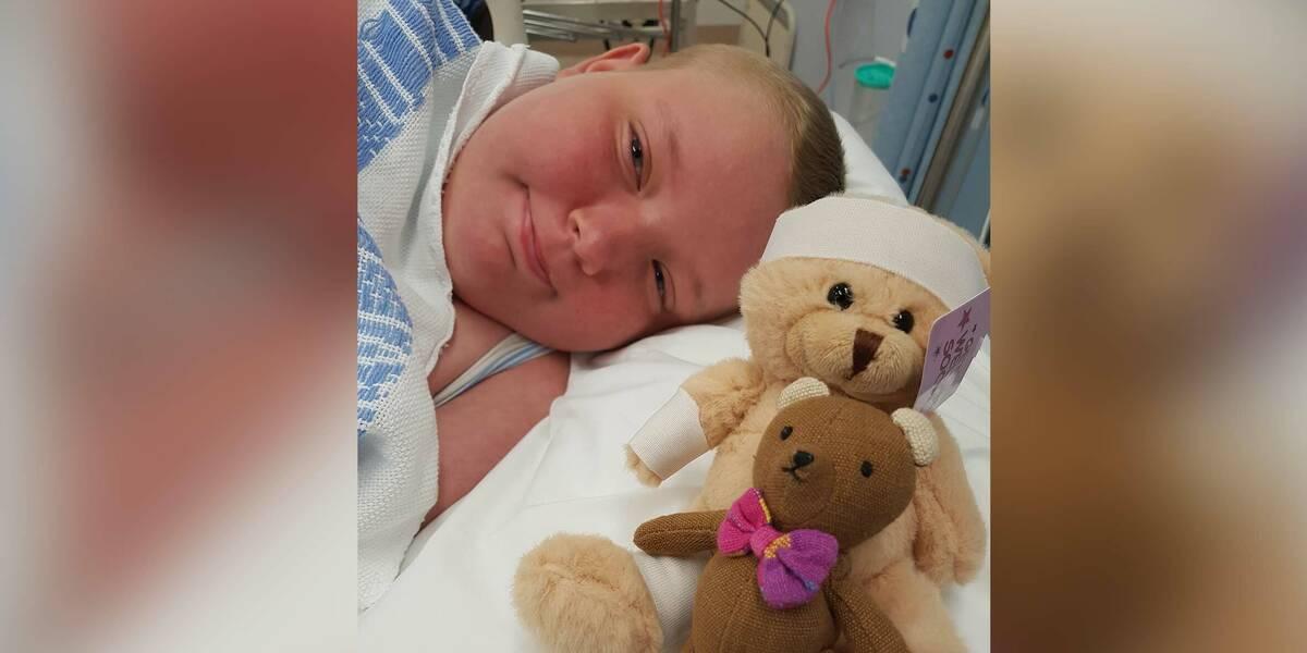 Make-A-Wish Australia wish kid Jacinta seriously ill in hospital bed with teddies