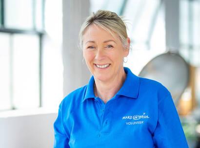Make A Wish Australia Children's Charity - female volunteer smiling to camera