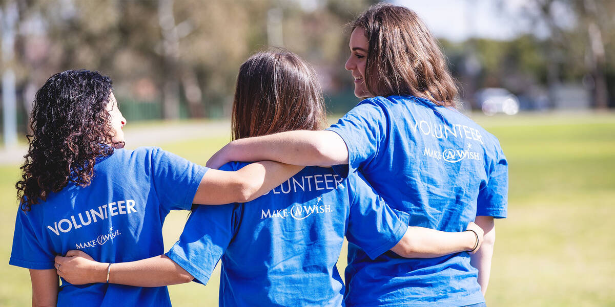 Make A Wish Australia Children's Charity - Female volunteers with arms around each other smiling