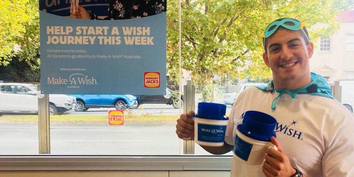 Make-A-Wish Australia event volunteer at a World Wish Day fundraiser holding collection tins