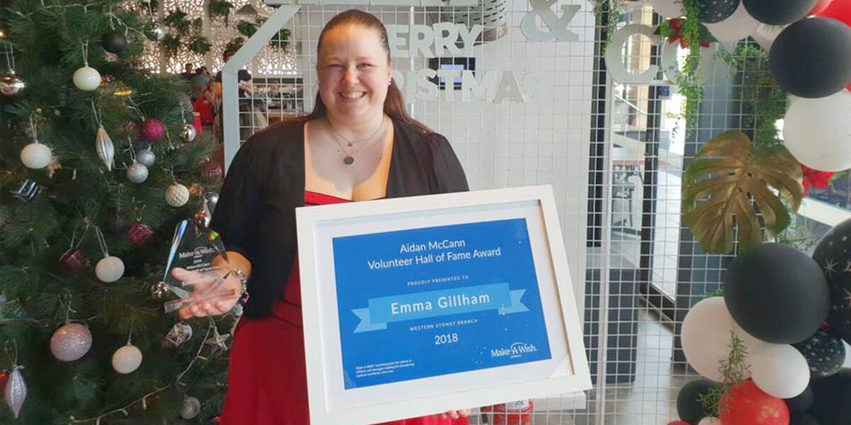 Make A Wish Australia Children's Charity - Hall of fame volunteer winner 2018 Emma standing with her certificate