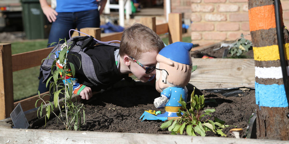 Make A Wish Australia Children's Charity - Noah on his wish in the garden with a knome