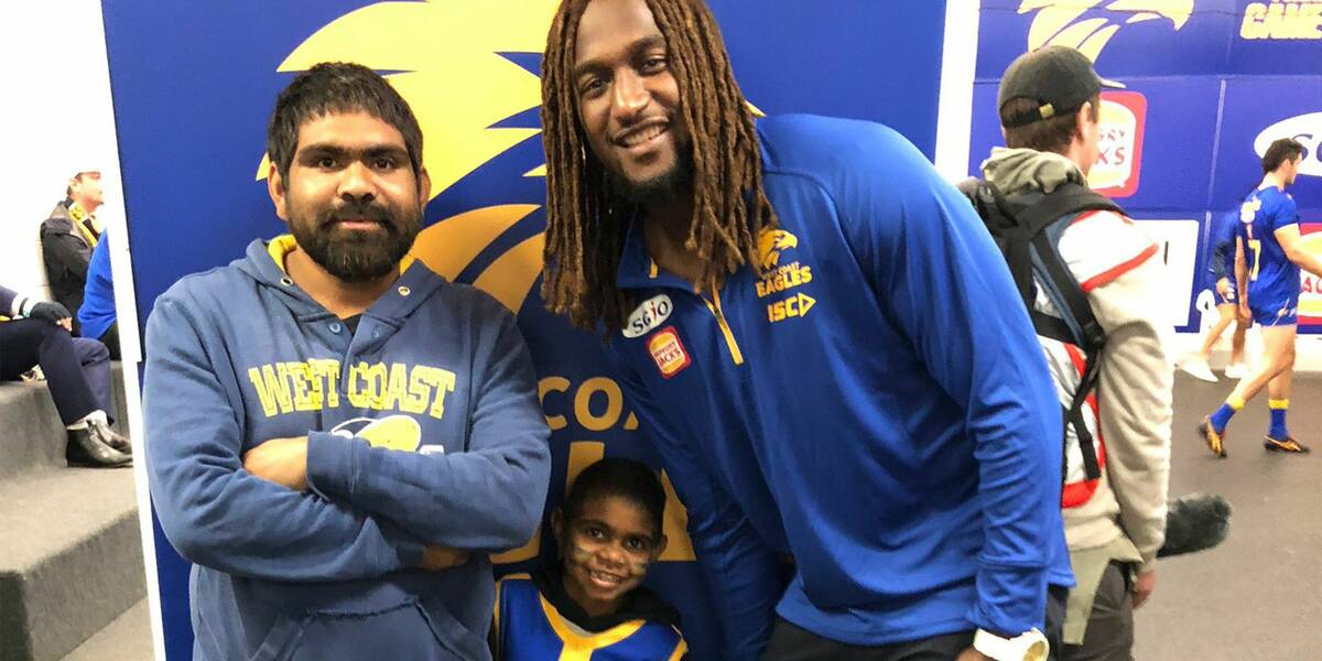Make A Wish Australia Children's Charity - Edgar on his wish with Nic Naitanui and the West Coast Eagles AFL team