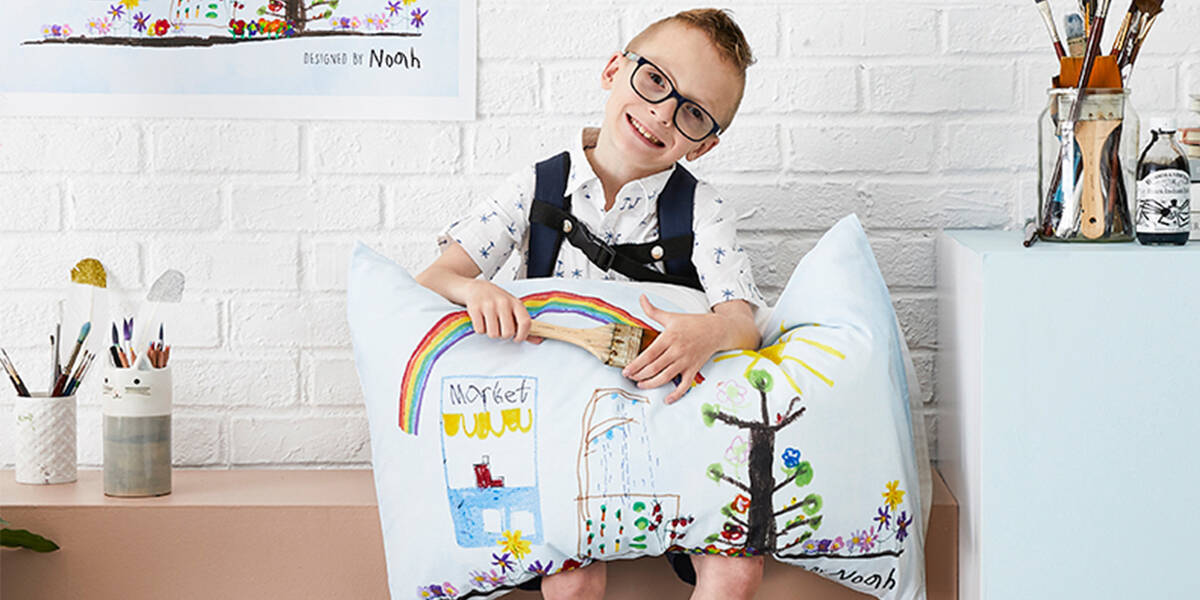 Make A Wish Australia Children's Charity - Noah with his Adairs pillow case he designed