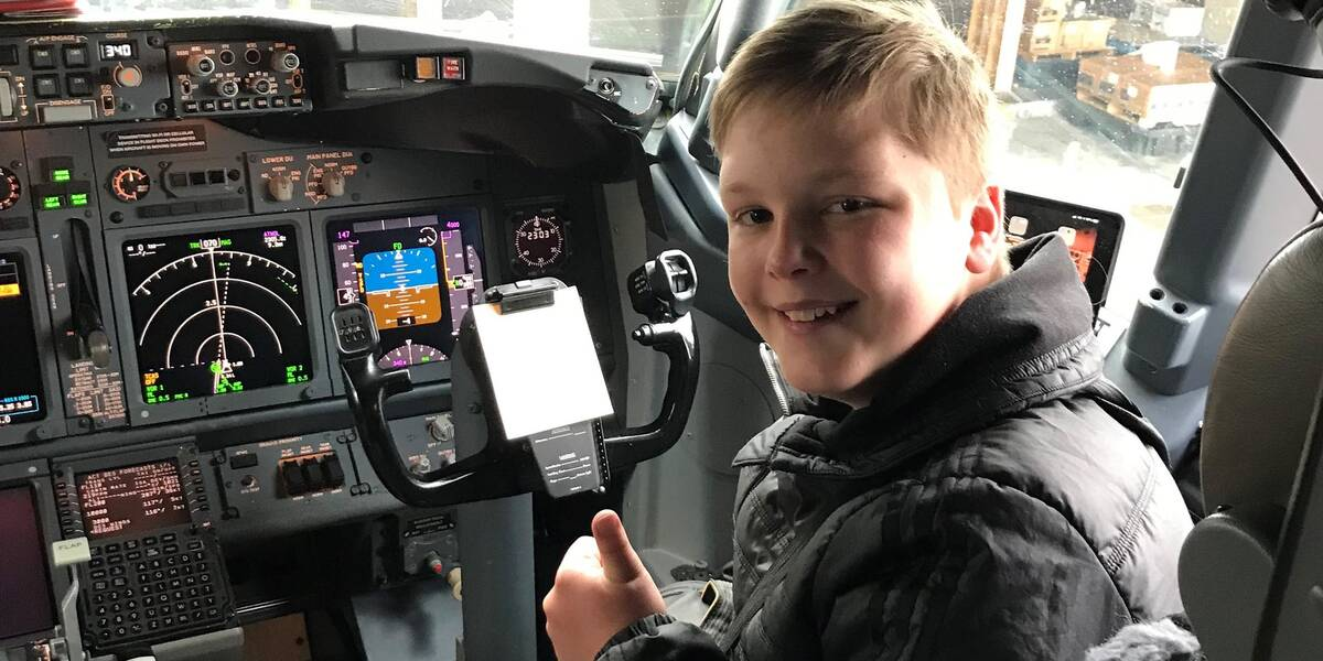 James sitting in the cockpit
