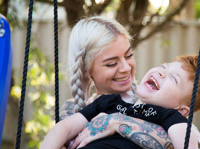 Make-A-Wish kid Levi with his mum on his swing