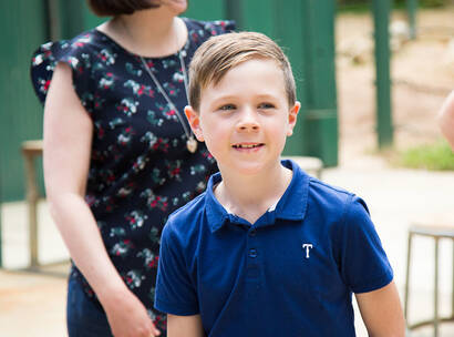 Make-A-Wish kid Henry, close up and smiling on his wish day to see animals
