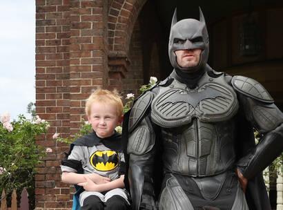 Make-A-Wish kid Rory sits next to batman on wish day
