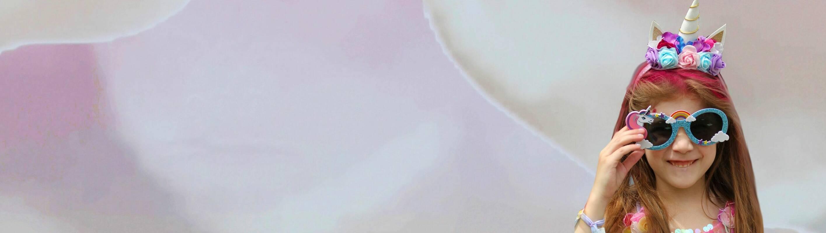 Make A Wish Australia, Children's Charity - Abigail on her wish wearing a unicorn headband and glasses