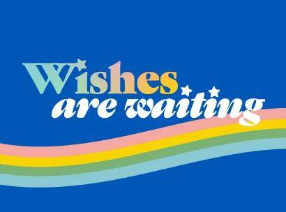 Wishes are waiting text on a rainbow background